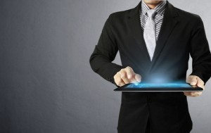 Business man touch screen ,touch- tablet in hands